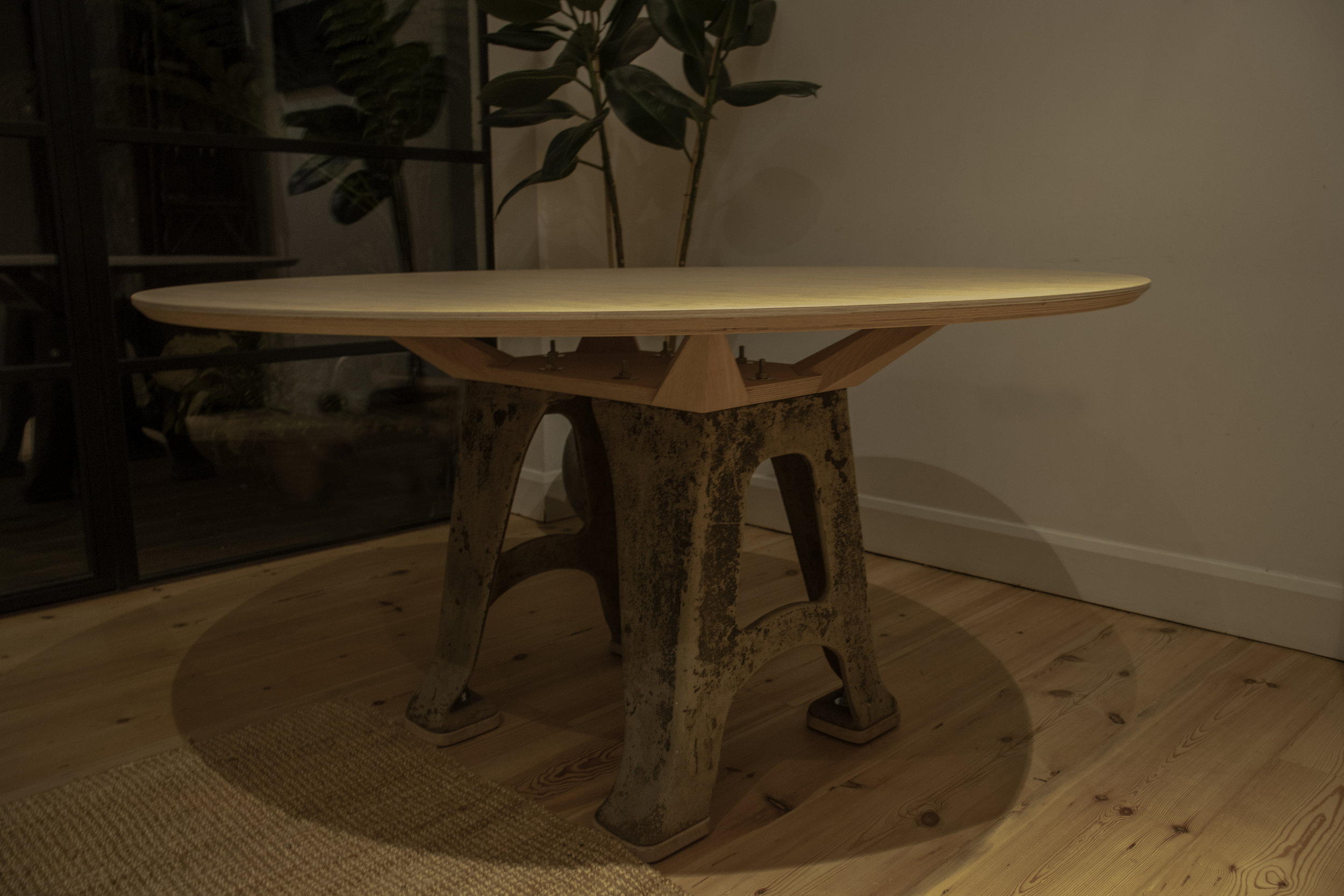 Oak dining table with a reclaimed industrial cast iron base. - This table utilises a reclaimed, industrial cast iron base. The oak, both in solid and veneer, has been bleached to achieve a blonde shade. The core of the top is birch ply.