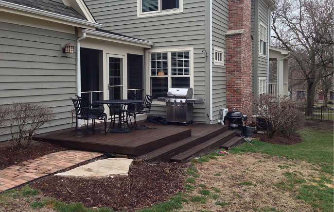 This before photo shows the small deck and slopping yard
