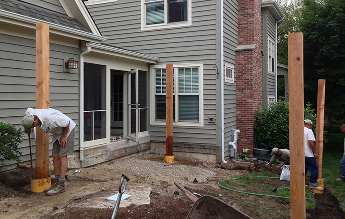 After the deck was removed, cedar posts are set to support the pergola.