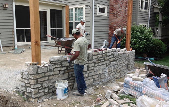 The pergola posts bear on a mortared stone wall, which will also retain the raised terrace.