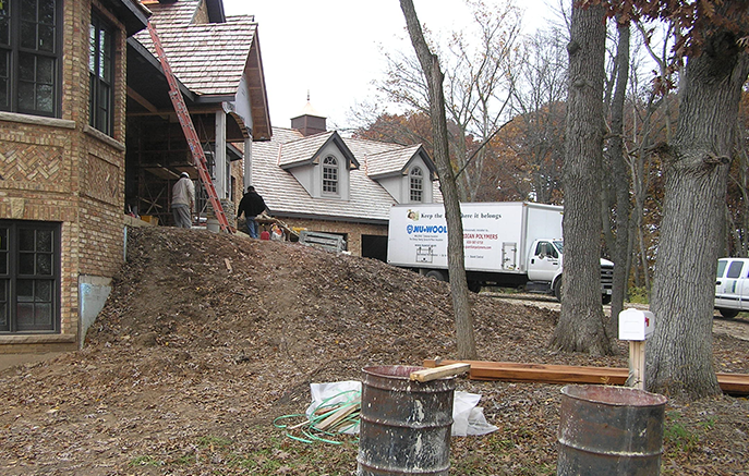 Hardscape construction begins at the front of the house.