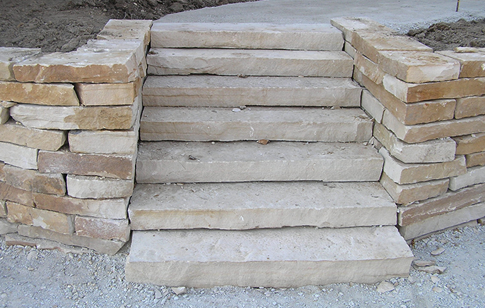 The cut stone has a more formal look appropriate for the front of the house.