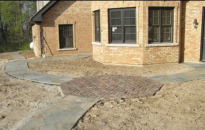 Backyard walkways are also Bluestone in a curving layout including an octagon of used bricks.
