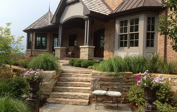 Plant combinations at the front door enhance the rustic character of the house and setting.