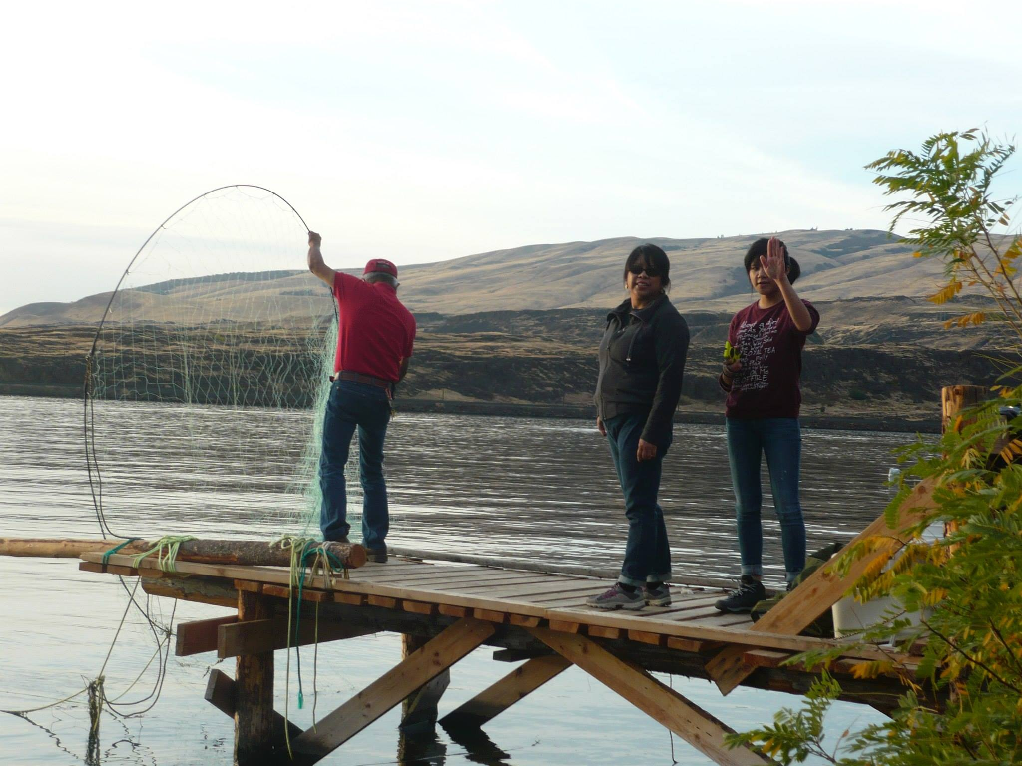 Fishing on scaffold above The Dalles Dam on the Columbia River.