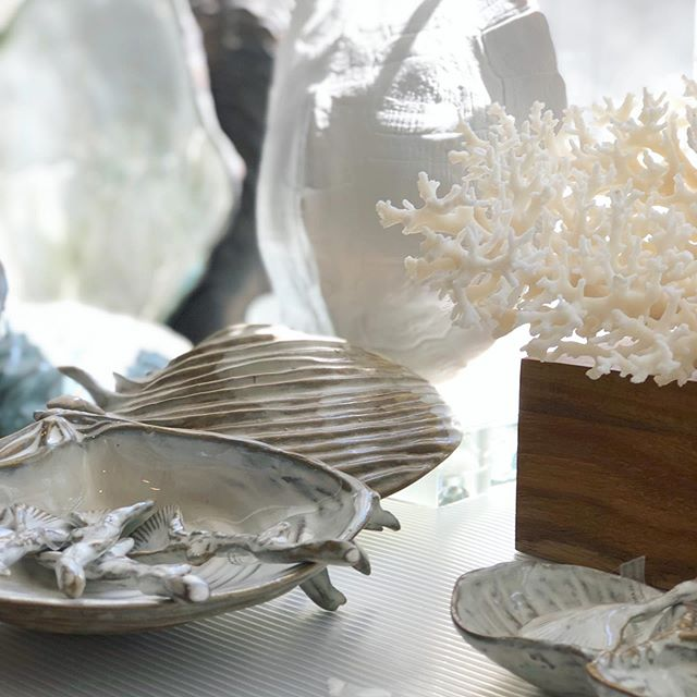 Hand-crafted from natural clays, this beautiful collection of ocean inspired serving pieces reminds us of the organic shapes, textures and colors of shells, salt and sand. #oysterplate #clambake #clamshell