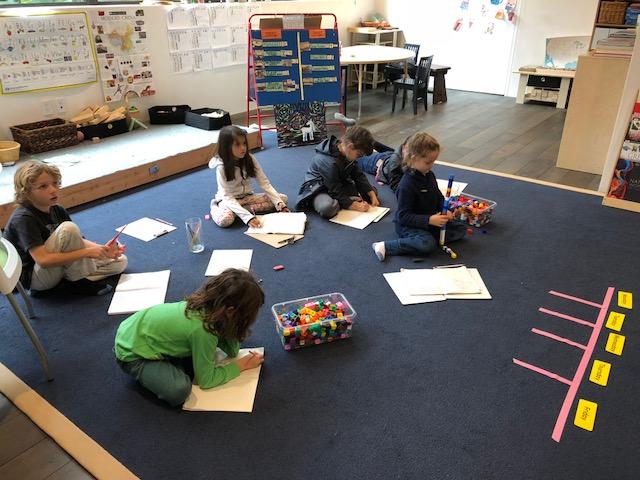 HS Serra math on carpet.jpg