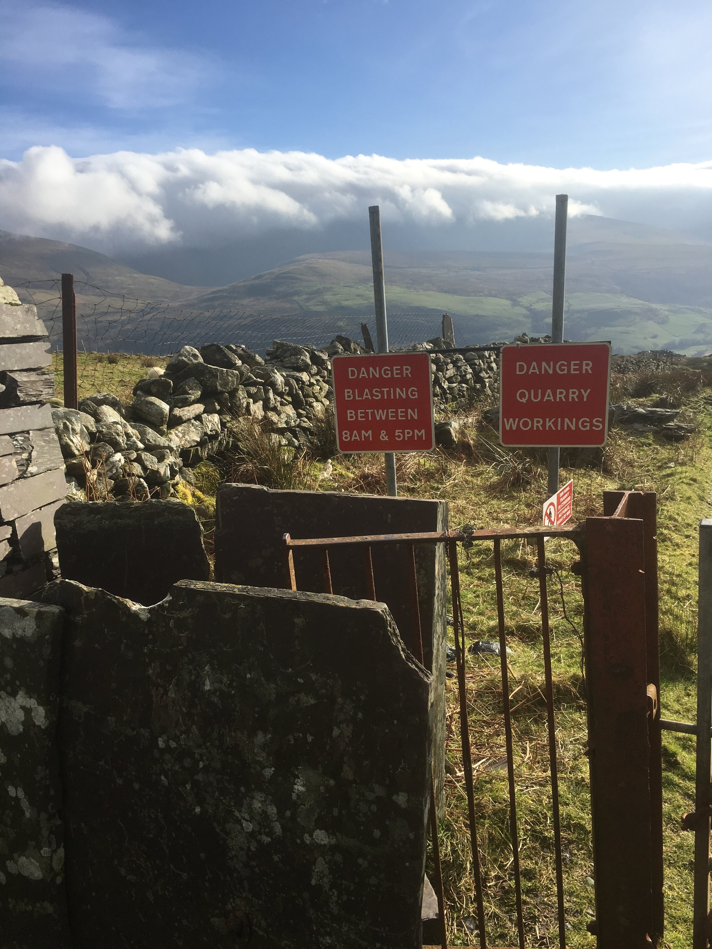 'Entrance' into Ellen Quarry in Y Fron, complete with no entry and warnings of blasting