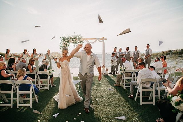 Keith is a pilot so this send off down the aisle with paper airplanes was SO FLIPPING ADORABLE