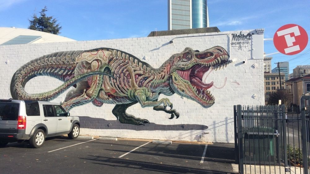 Oakland Flax's new mural by Nychos greets customers in the parking lot.