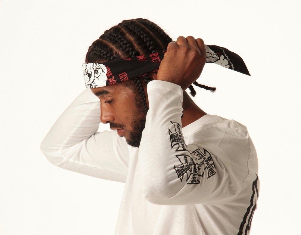 Male model posing for camera in bandanna