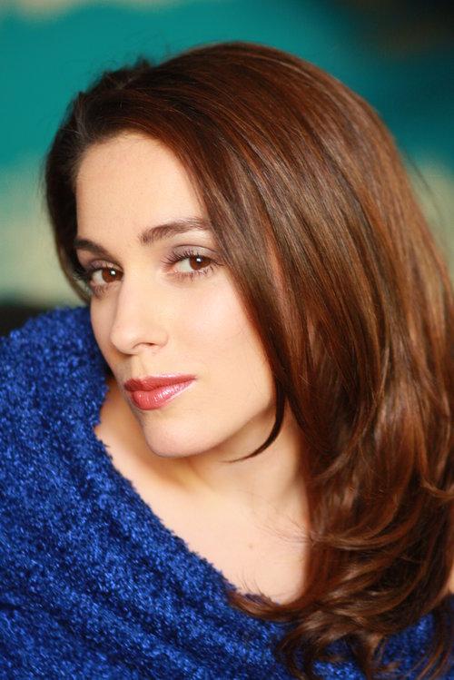 Female model Headshot in a blue blanket