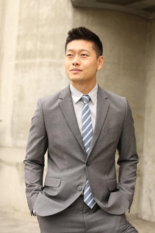 Male model Headshot in grey suit