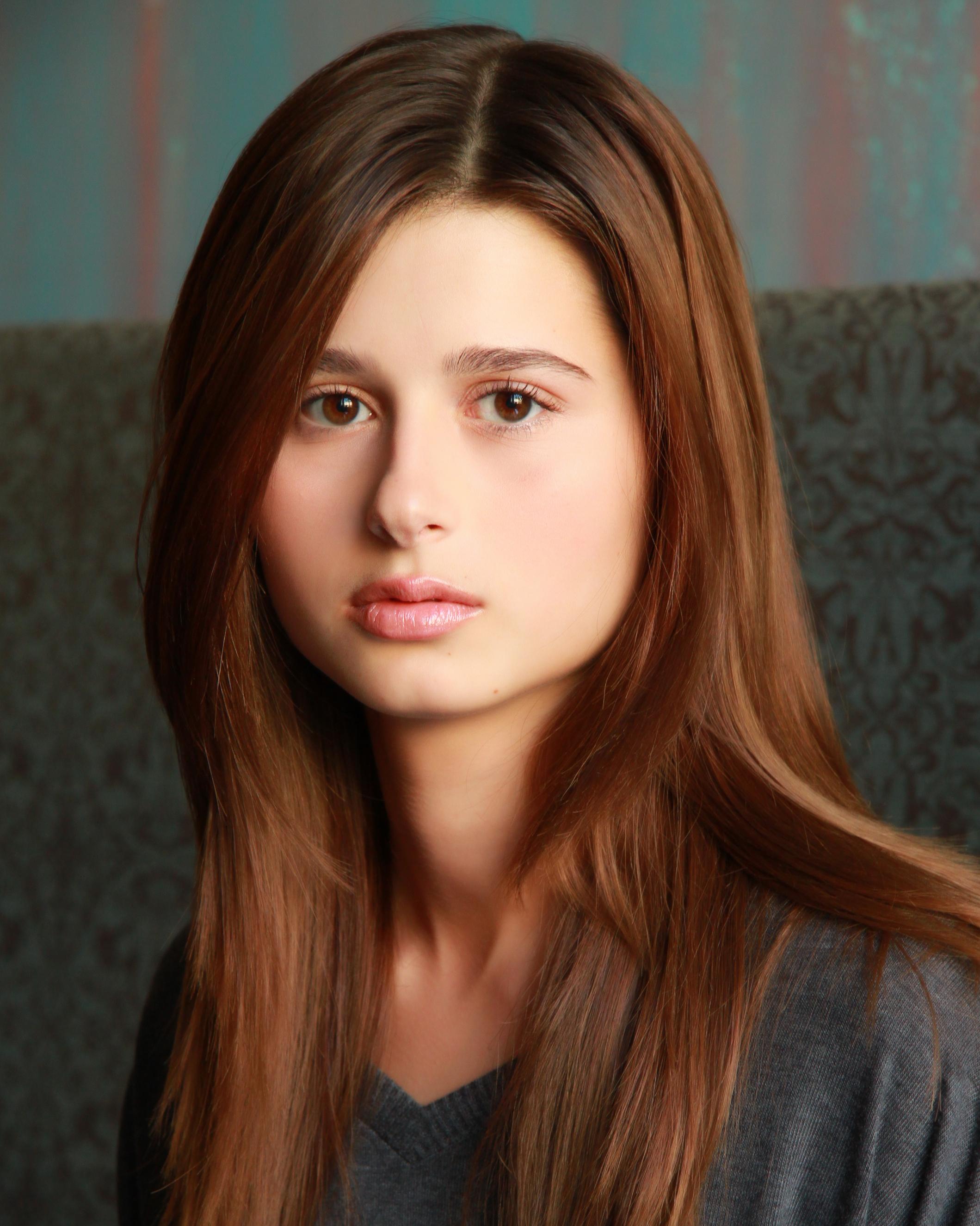 Female model headshot in grey shirt