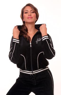 Model posing in black sweatsuit