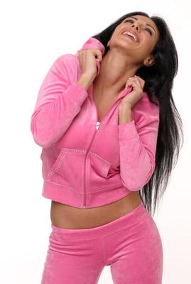 Model posing in pink sweatsuit