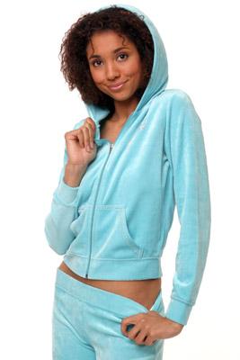 Model posing in blue sweatsuit
