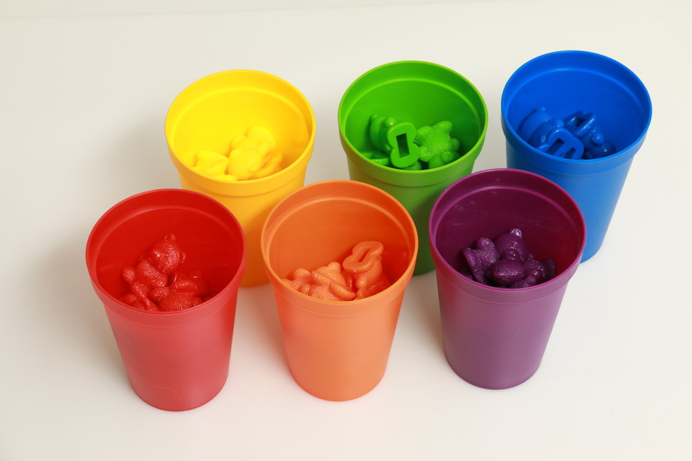 Plastic cups with plastic bears inside