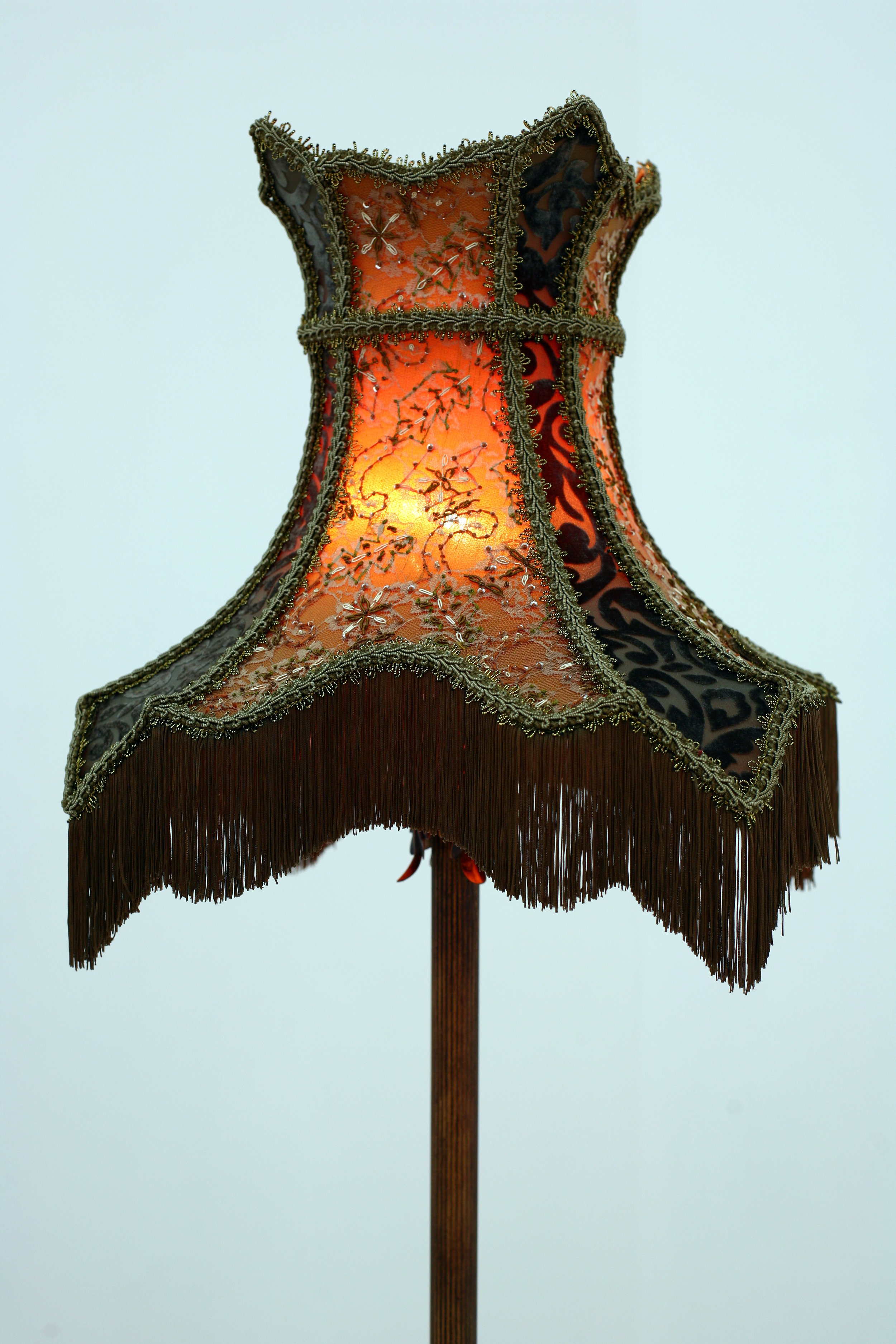 Uniquely shaped antique lamp with custom lamp shade