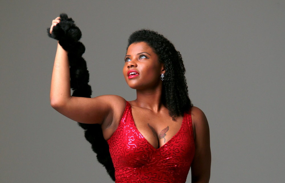 Musician posing in a red dress