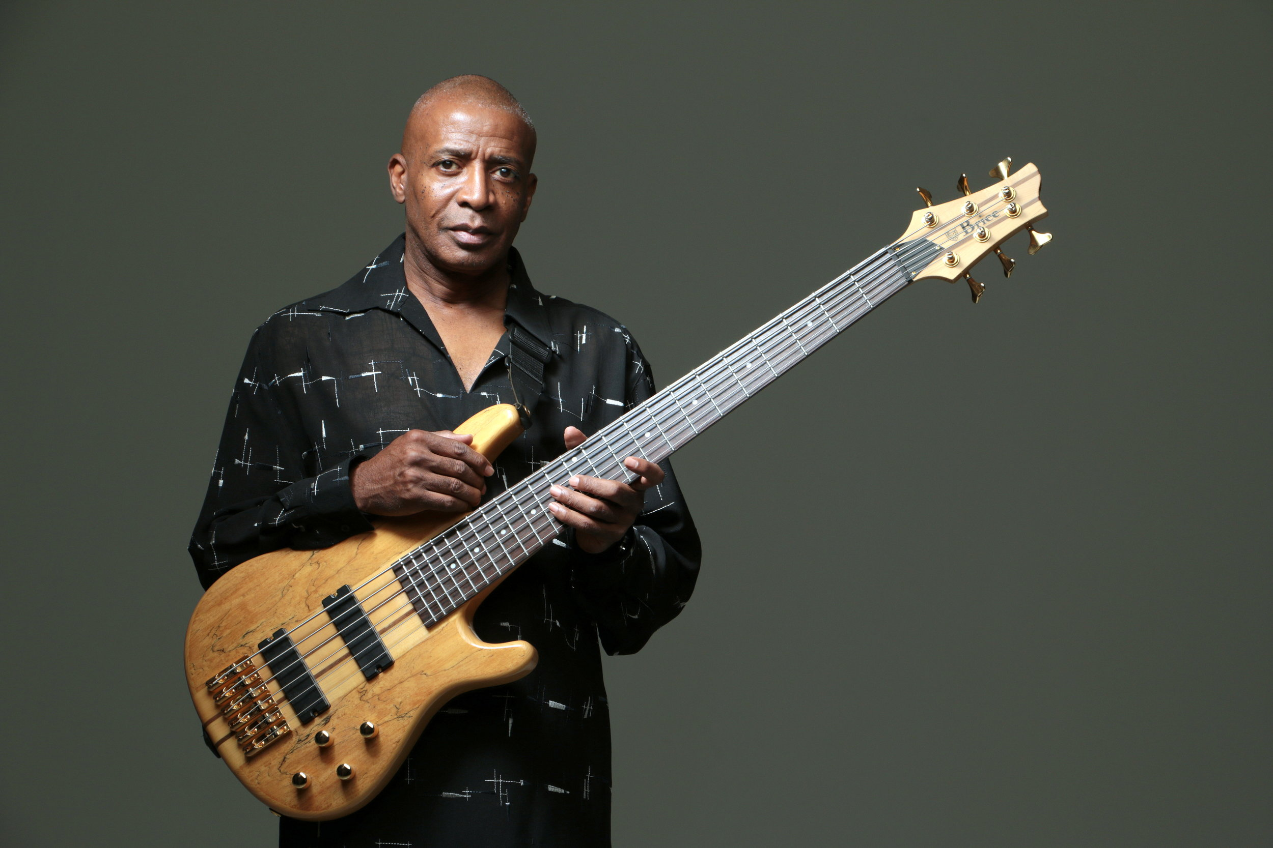 Musican posing with his bass guitar