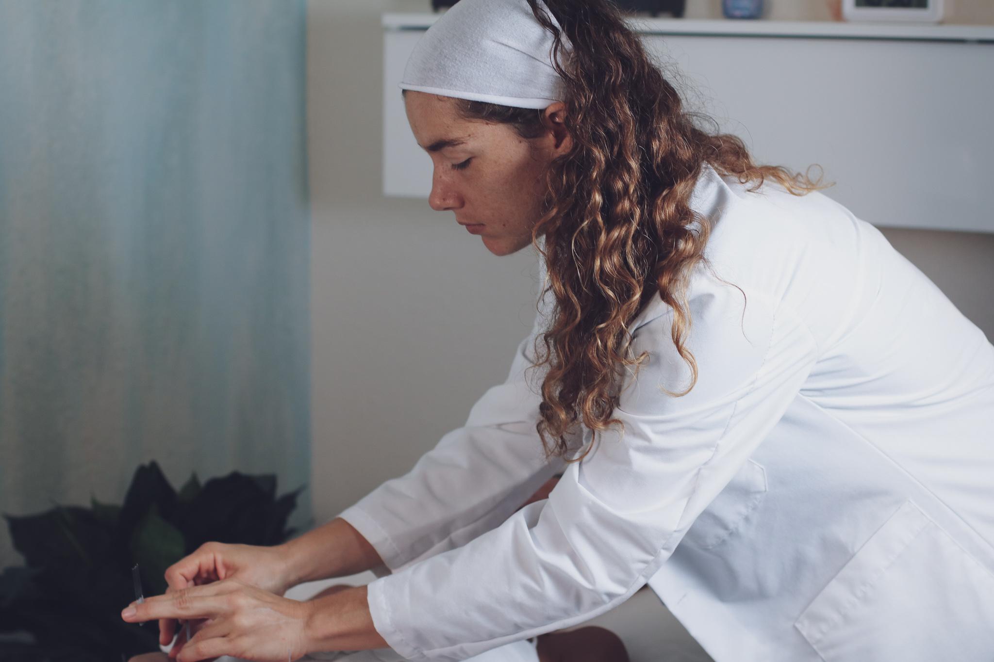 Dr. Amanda administering Acupuncture
