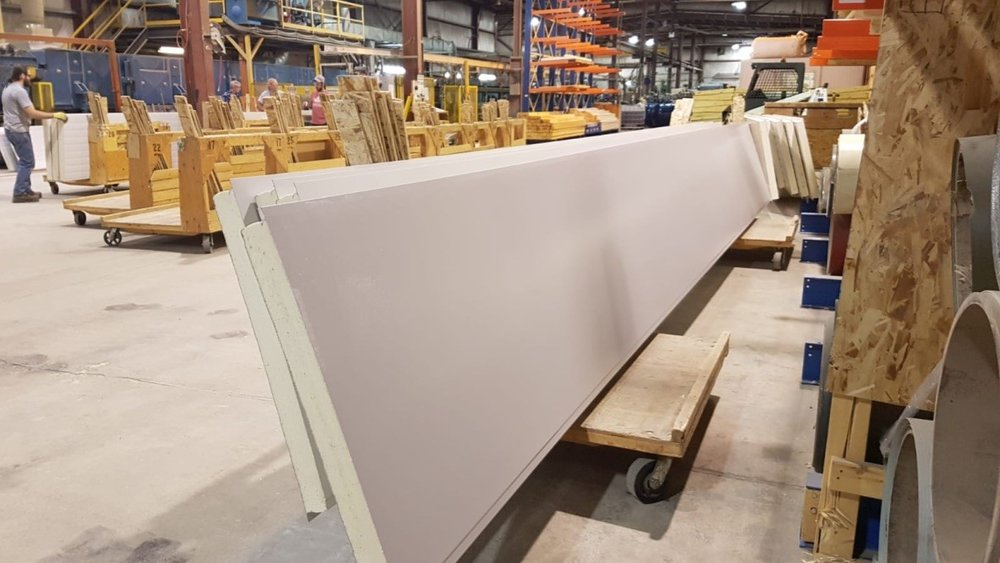 Exterior wall panels manufactured