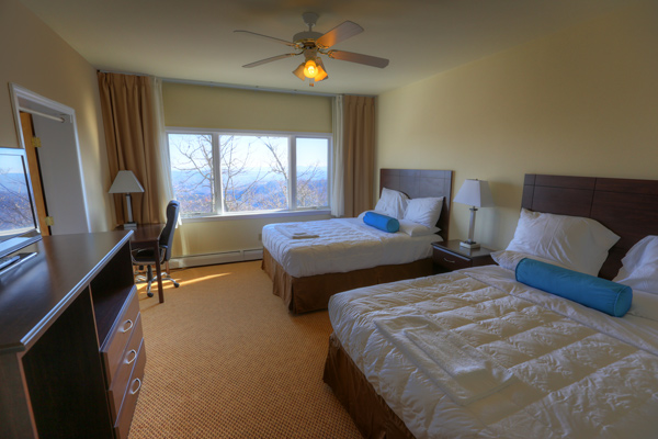 PACKAGE 2 - HOTEL ROOM SHARED W/ PRIVATE BATH Features: Private Bath, Mountain Views, Air Conditioning, Flat Screen TV, Wifi, Mini Fridge, Two Double Size Beds, Complimentary Fruit & Tea