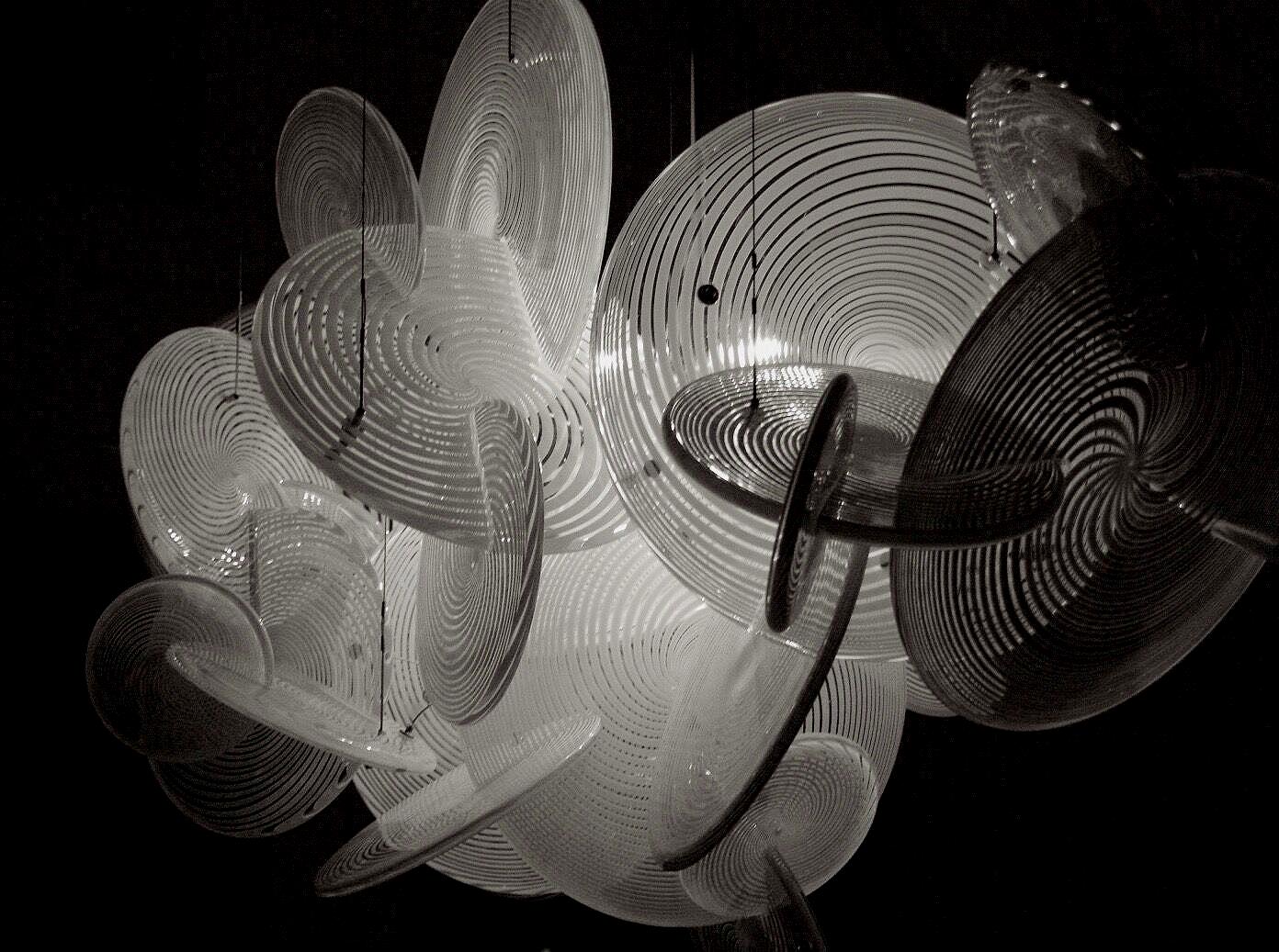 "Venetian Hypnotic Illuminated Sculpture  Hand Blown Glass Venetian Discs, Stainless Steel, Light Dimensions: 56"" wide x 32""H x 62"" Drop By Deborah Czeresko"