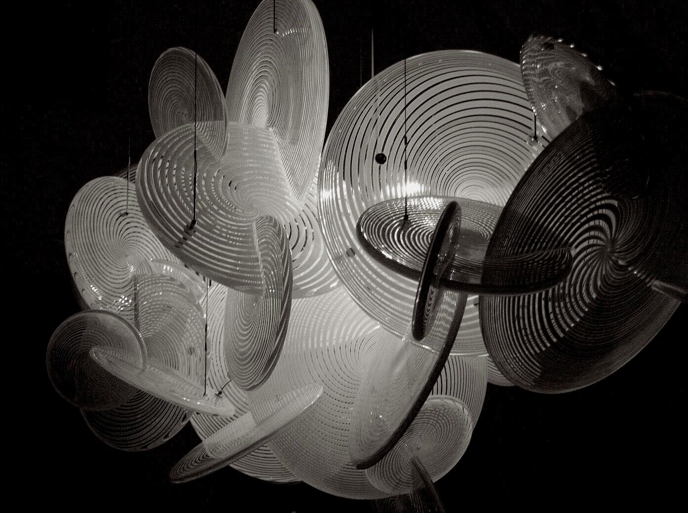 "Venetian Hypnotic Illuminated Sculpture  Hand Blown Glass Venetian Discs, Stainless Steel, Light Dimensions: 56"" wide x 32""H x 62"" Drop"
