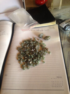 A packet of rough demantoid garnets from the erong region of Namibia