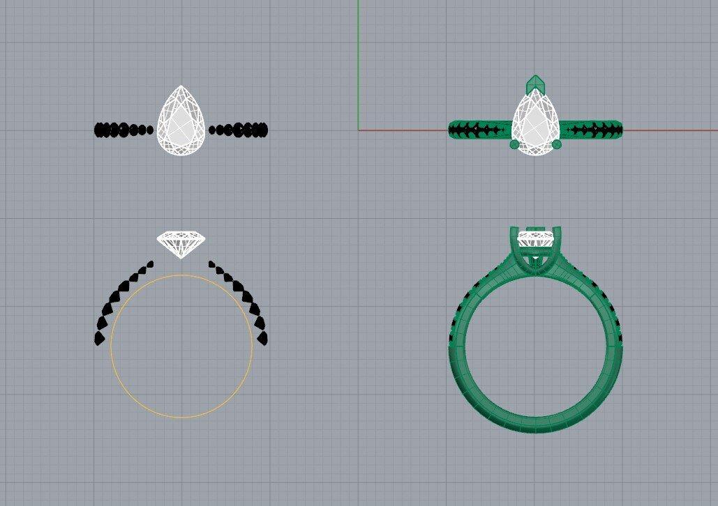 Pear cut diamond engagement ring side stones.jpg