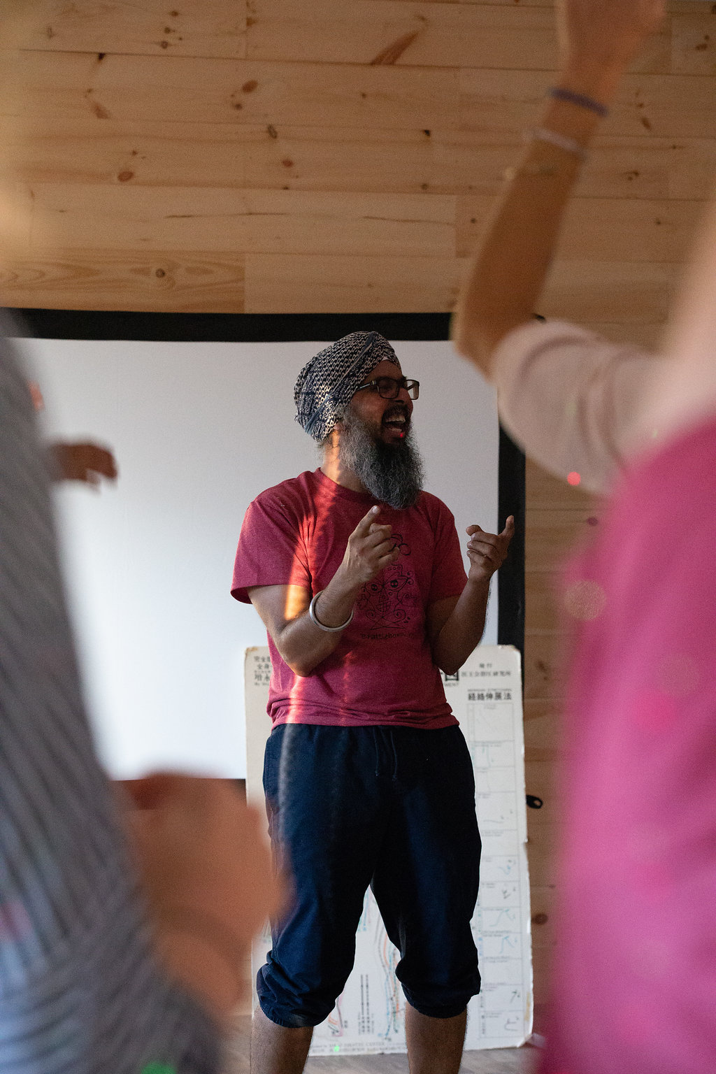 """Harmeet Singh,   General Council and Husband    Harmeet was born and raised in India where he experienced the culture that yoga flourishes within, from a mother who cooked using Ayurvedic principals, to a father who took a disciplined and devotional approach to physical asana practice; and from studying the spiritual texts to learning verses and mantras.   At the age of 18, a more serious practice of asana began as a means to solve for a lower back problem. At the time, bare-floor practice was how things were done, no engineered Manduka mats cushioning his jump backs. He started practicing at a local shala with a master teacher who had little time for frills. Upon arrival, he saw students being yelled at and poked and prodded with a stick that appeared to be the teachers best friend. The teacher asked him only one question upon accepting him as a student, he asked, """"have you arrived"""". Harmeet responded confused, """"yes"""". The teacher then repeated that mantra four more times, with Harmeet becoming increasingly confused. After a sufficient number of responses, he proceeded to teach Harmeet a series of asanas, allowing him to practice on his own after a few attempts. Harmeet, thinking he was progressing along was feeling happy about his practice, but was soon caught distracted. The medicine for this type of distraction was…a sharp stick poke in the side, followed by the question, """"You told me you arrived in body and mind. So, why did you leave?"""" This story resonated with Harmeet and he has aimed to create presence and a focusing inward in all that he does.  In his current work, Harmeet is a  Director of Innovation  and teaches creative thinking to many technically oriented professionals in the software industry. The ideas fostered through his work have become product offerings with top-tiered tech giants.  Through Setu Harmeet looks to promote laughter and North Indian dancing, in conjunction with meditation through different modalities. Harmeet also practices Ashtanga Y"""