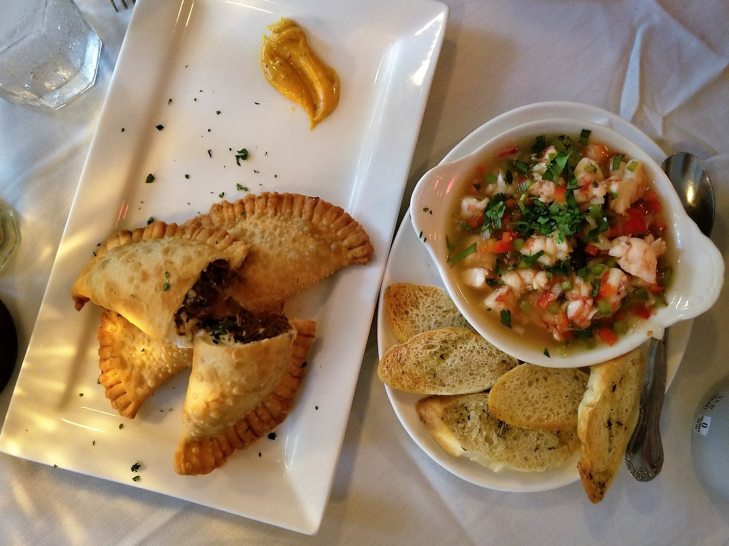 We did all tapas that evening which included the beef and goat cheese empanadas and shrimp ceviche (both pictured). Two other items not pictured (because it got dark in the dining room and the lighting was not great): Gambas Mozambique (shrimp sauteed with fresh garlic, paprika and parsley) and Escargot Andalusia Style (flambeed with brandy, garlic, onion and a creamy tomato sauce). We topped the meal off with a piece of tres leches cake, my all time fave.