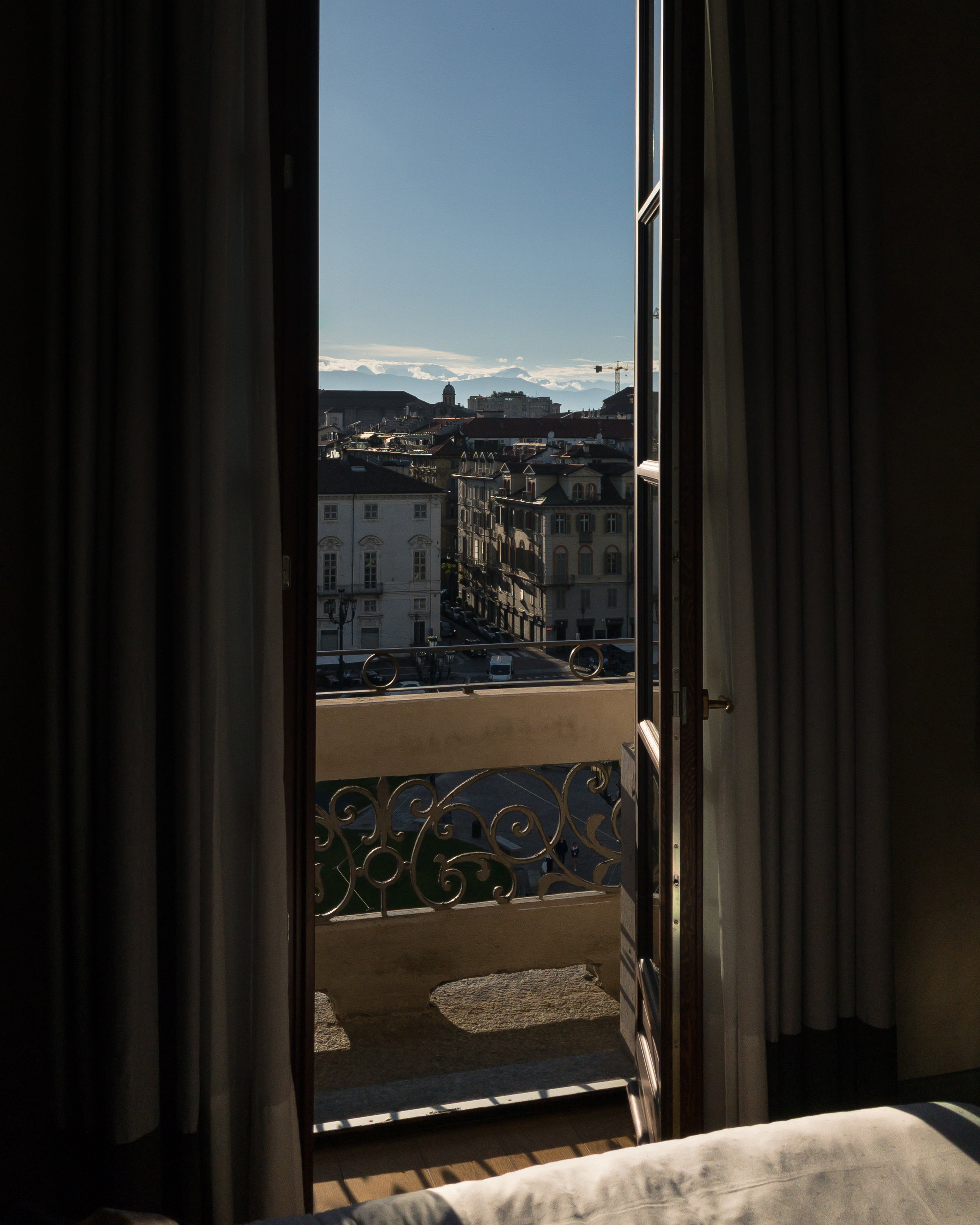 """During our two night stay in Torino, we stayed at the  NH Collection Torino Piazza Carlina . It was in a great location and the room was spacious with a modern and minimal design aesthetic. Right outside the door to our room was a balcony that overlooked an interior courtyard and lounge chairs available to hang out on. There's a mini tour of our room on my IG """"Italy"""" highlights reel if you want to see more. Breakfast was included, which was nice - one less meal to not have to worry about. This hotel was the perfect place to lay my pretty little head down each night."""