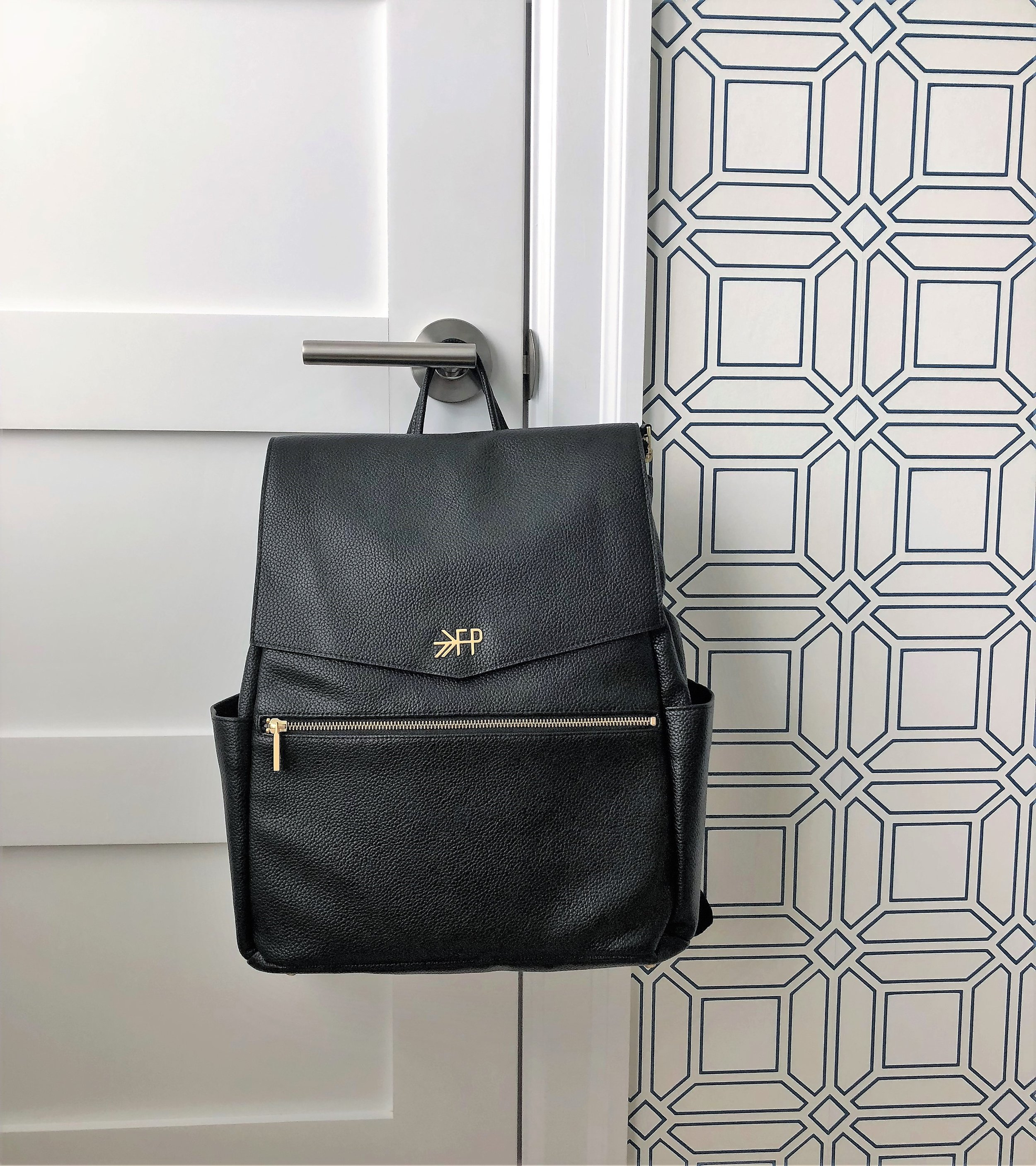 When it came to diaper bags, I knew I wanted a back pack. I also wanted one that was simple and didn't look like a diaper bag, if that makes any sense. On one shopping trip to Nordstrom, I found and tried on this faux leather one by Freshly Picked. I didn't immediately buy it mainly because of the price ($175) and I wanted to make sure to shop around first. After searching high and low, I decided that this was the one I wanted. It's pretty spacious, has plenty of pockets and can be easily wiped clean. This bag is available at  Buy Buy Baby  and I was able to use a 20% coupon ($140)!