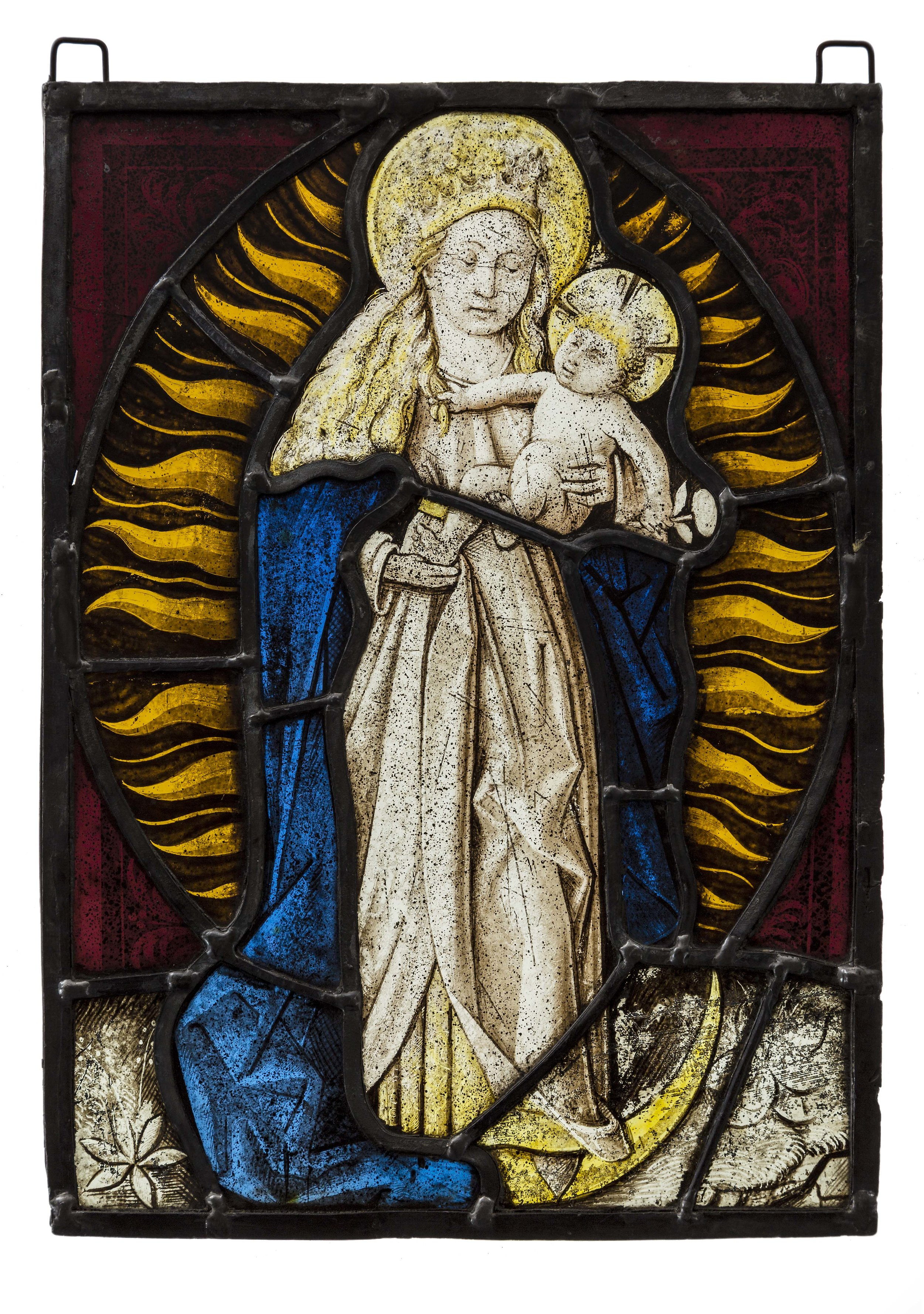 """Artist unknown, Flemish Stained glass, c. late 15th century, The Virgin is depicted as the """"Woman of the Apocalypse"""", and is set against stylised sun rays with the moon at her feet; """"the sun for her mantle, the moon under her feet"""" (Apocalypse of St John 12:1-2), 27 x 20 cm Australian Catholic University Art Collection Acquired 2017. Image courtesy of ACU University."""