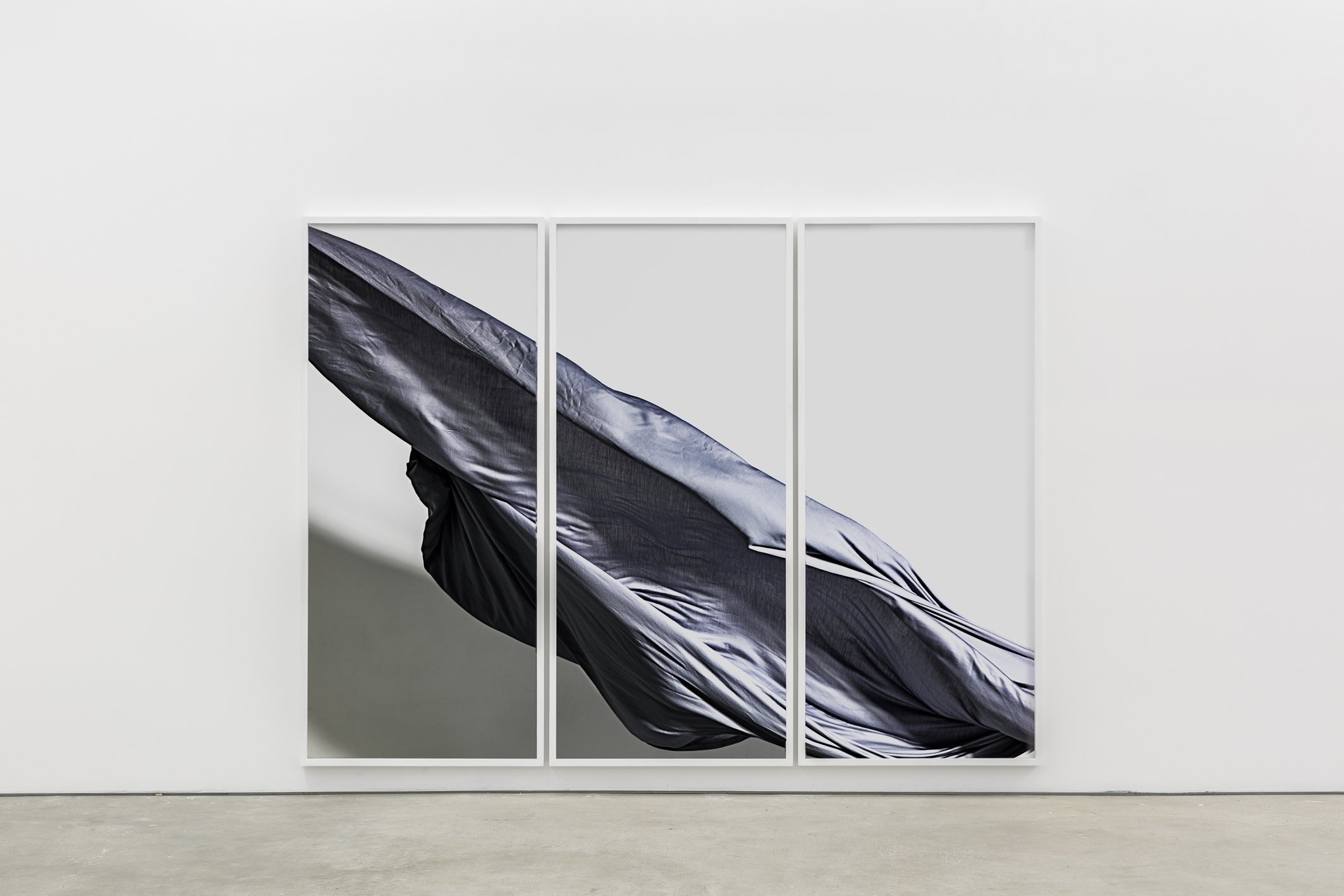 Nik Pantazopoulos,  to unfurl IV (A6007550) / a king size bedsheet / mid grey / the act of making / juddering / dispersing / 2 x Elinchrome flash heads / light value 4.4 / angle of incidence 45o / cable synched to Canon EOS 5D Mark III / EF85mm / f/1.2L II USM Lens / f/8.0 1/80 iso 100 / temperature 5900oK / white acrylic / Tasmanian Oak / perspex / pigment print / 180 cm height x 80 cm x 3, width 6 cm depth 3 cm / 2017