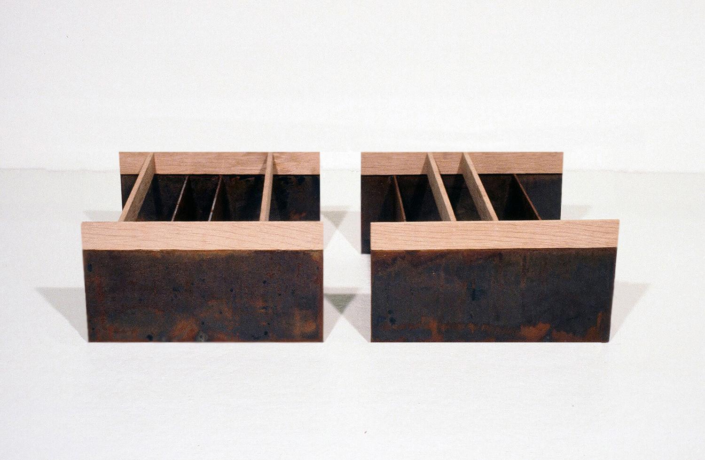 1978, Mild steel, oak, 5 x 22 x 10 inches.