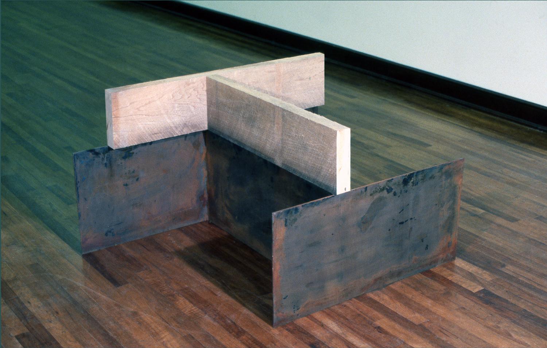 1979, Corten steel, rough cut poplar, 27 x 48 x 48 inches.