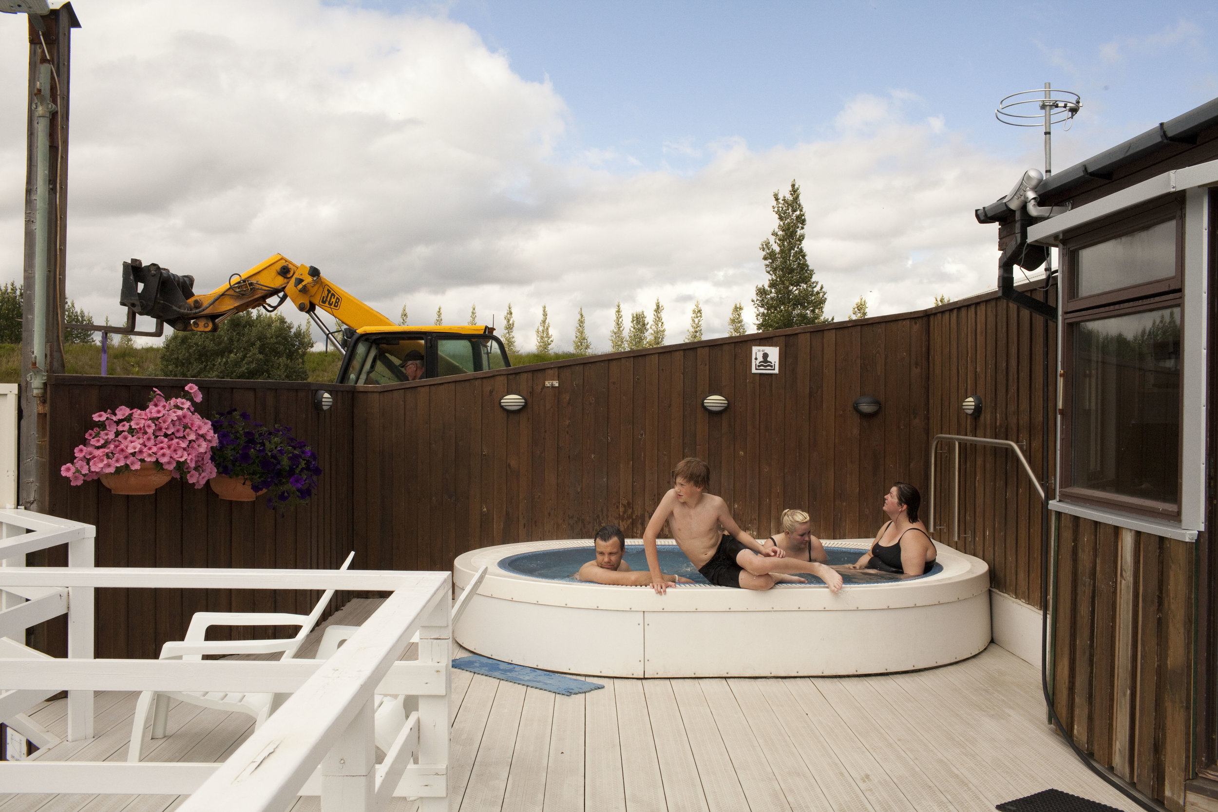 A family soaks in the hot tub at a pool in Fludir, a small Icelandic town of around 400 people.