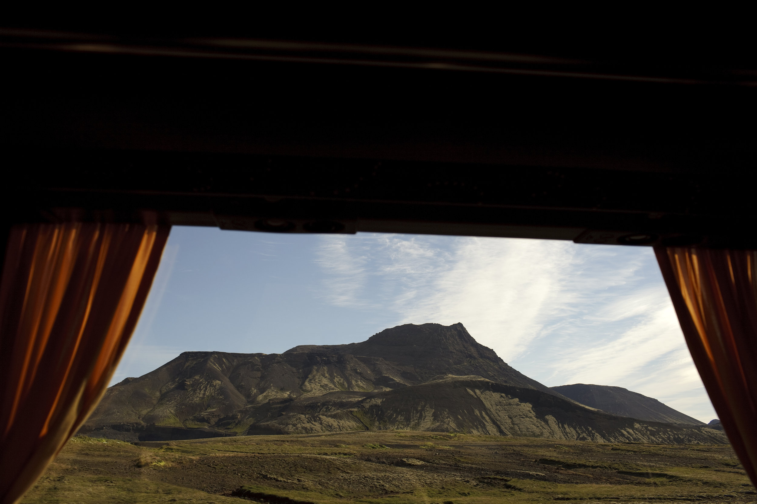 A mountain view from a bus window, headed back into Reykjavik from a small town in southern Iceland.