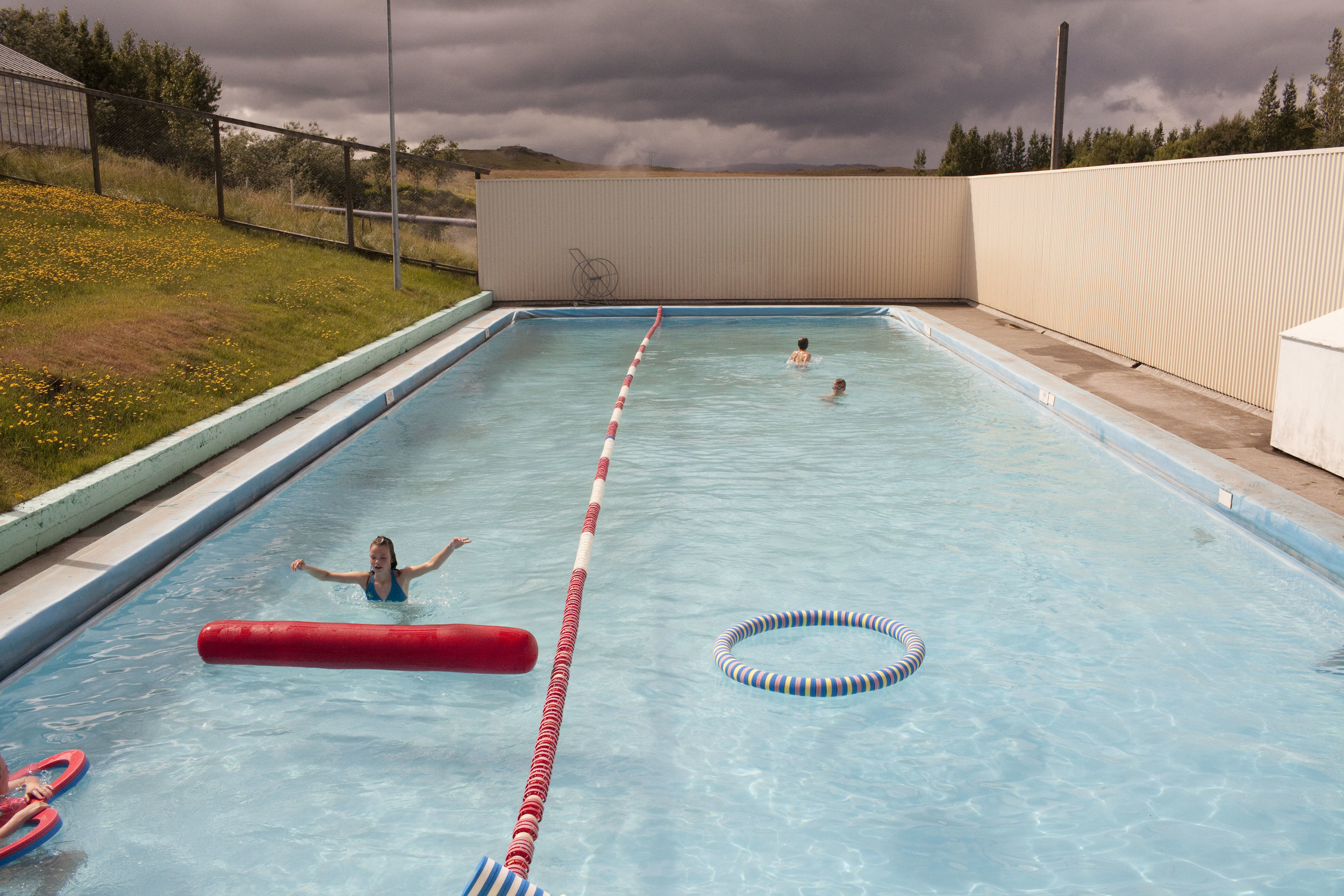 At the community pool in Fludir, Iceland. The small town of about 400 people is situated in the mountains and its scenery makes it a popular vacation spot for many Icelanders in the summer months.