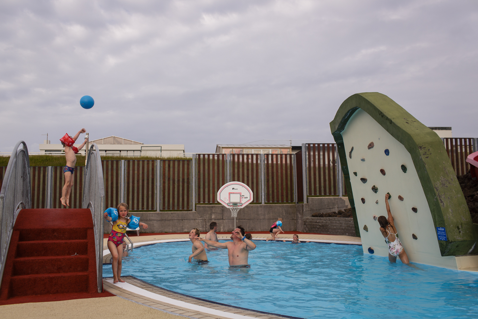 People enjoy the public pool in Heimaey, an island in the Vestmannaeyjar Archipelago off the southern coast of Iceland.