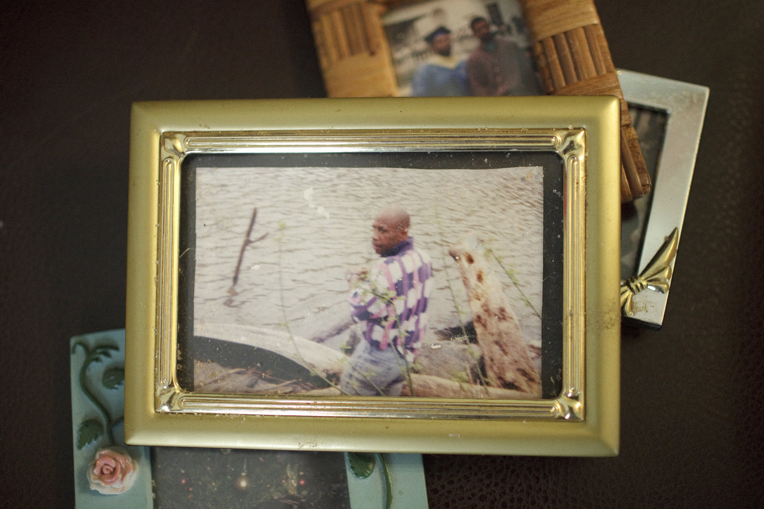 A framed photo of Kojak at the river, taken years earlier. For many, fishing at the river has been a part of their lives for decades.
