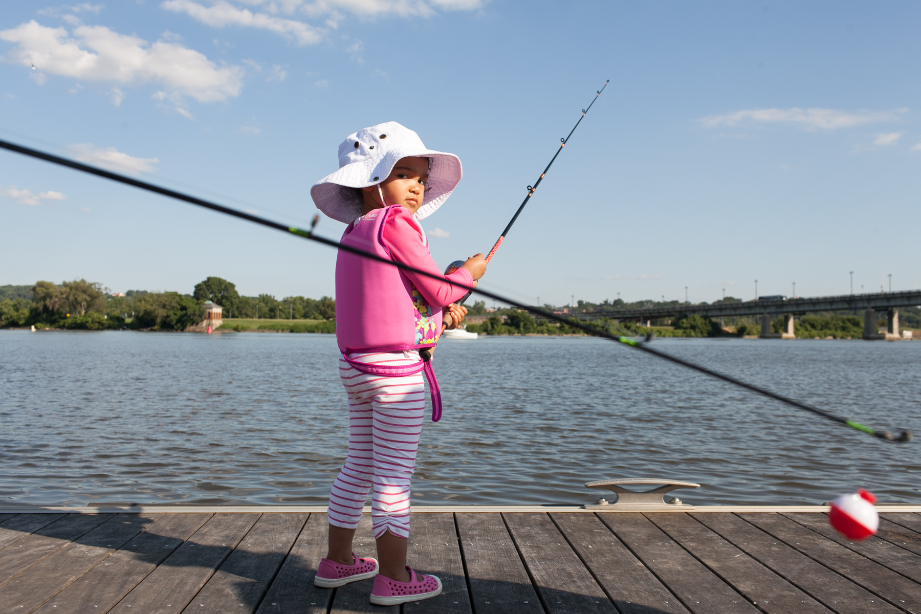Friday Night Fishing, a free event where kids learn how to catch and release fish, from the pier by Nationals Stadium in Diamond Teague Park.