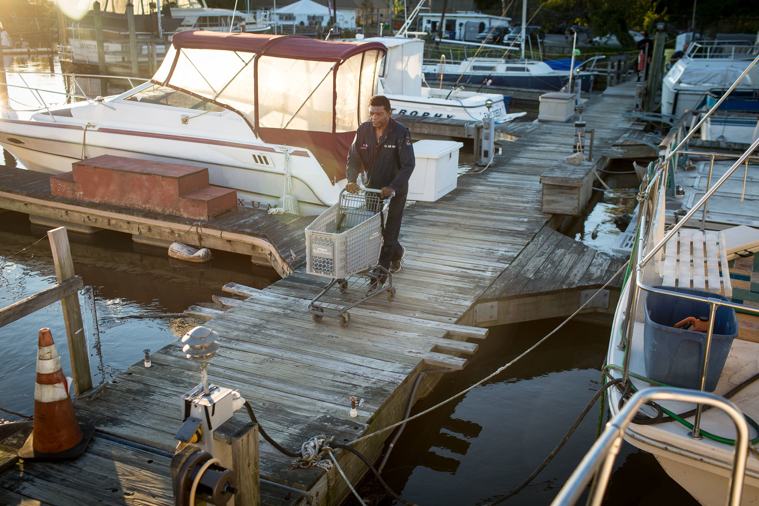 """James """"AJ"""" Hall walks down the dock at Seafarers to his boat,  The Raven , on a Sunday evening in autumn of 2015. He died of cancer a little over a year later."""