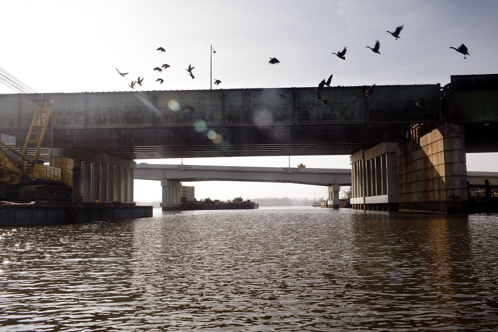 Birds flock past the 11th street bridge, which crosses the Anacostia River, connecting Capitol Hill with the historic Anacostia neighborhood. The pillars of the old 11th street bridge are the proposed site of a future elevated park that's estimated to cost 45 million dollars.