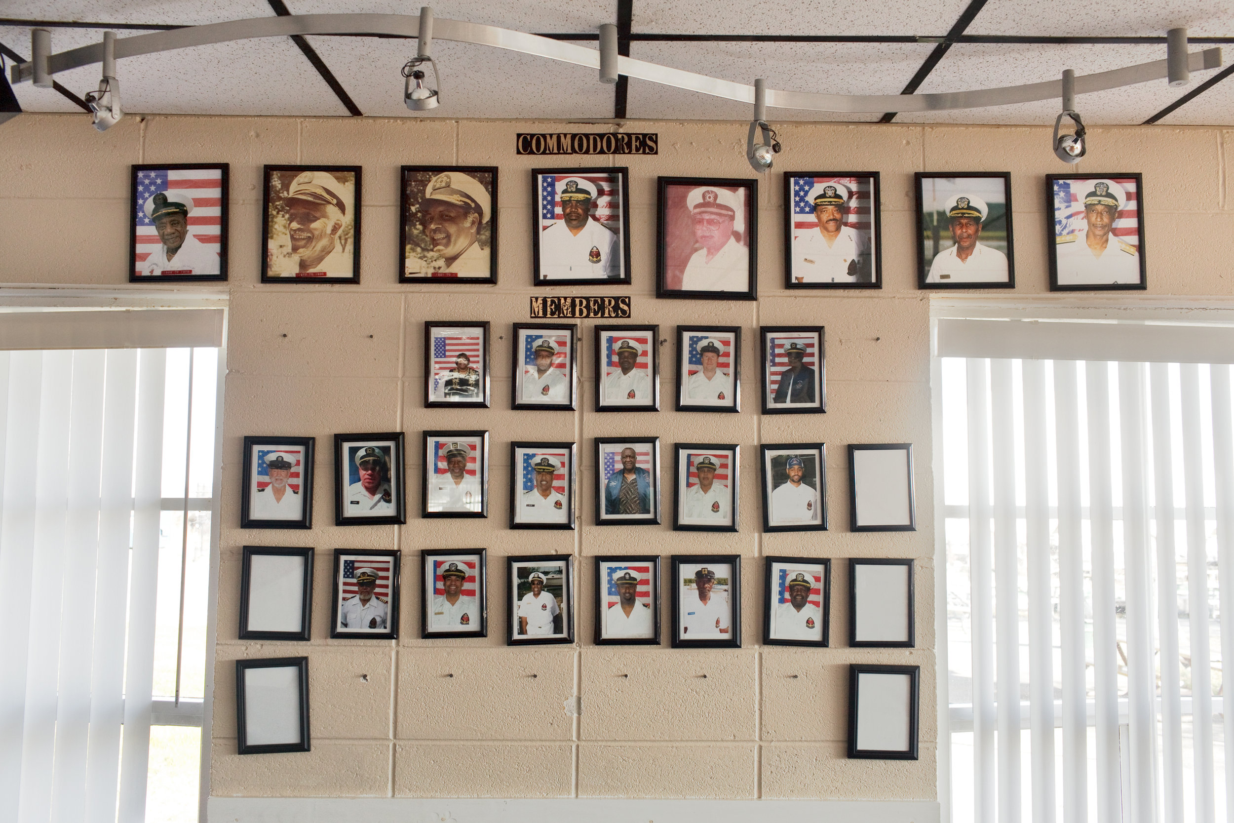 Photographs of past Seafarers' commodores and members hang on the wall inside the clubhouse.