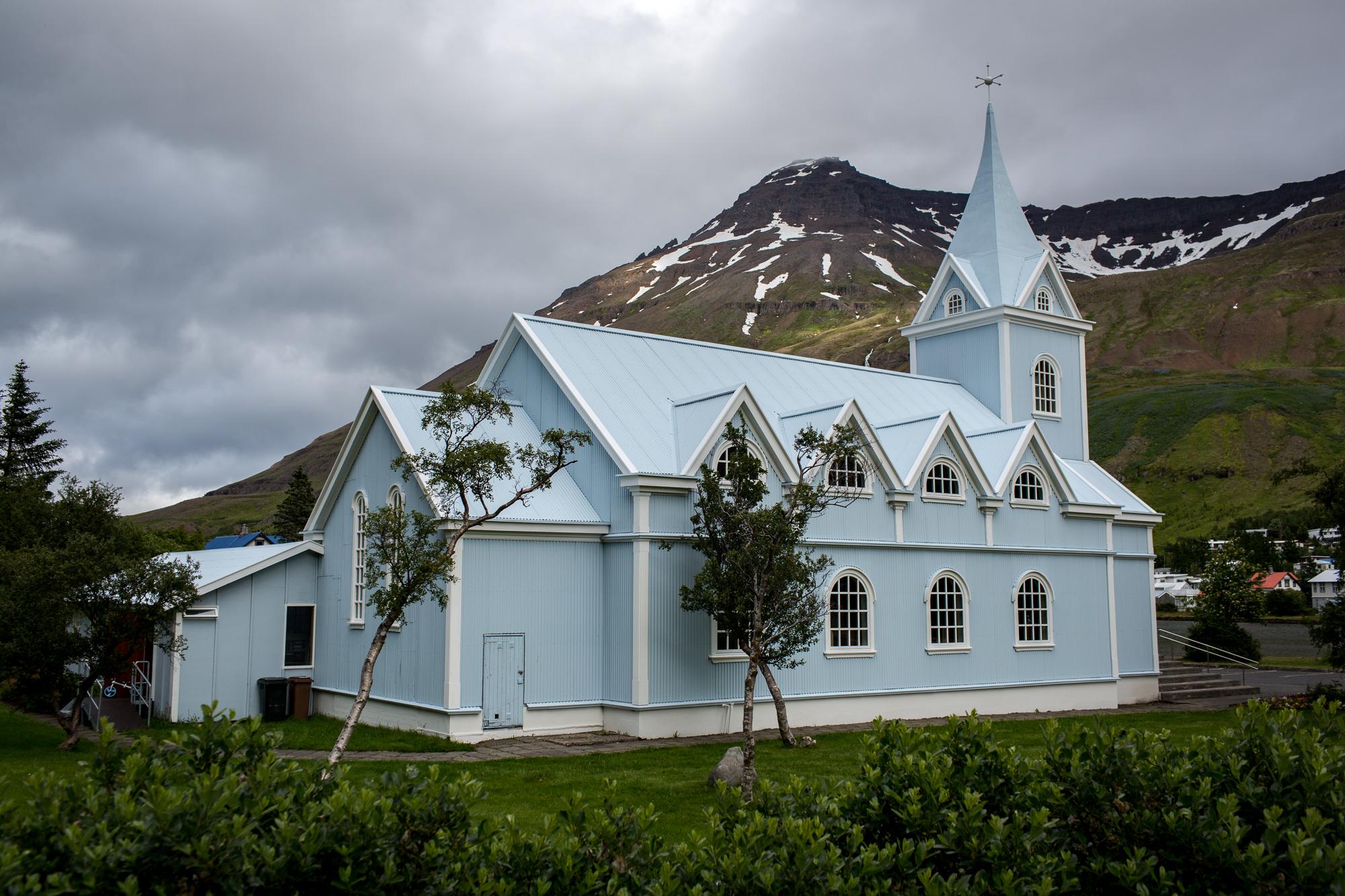 A baby blue church in Seydisfjordur
